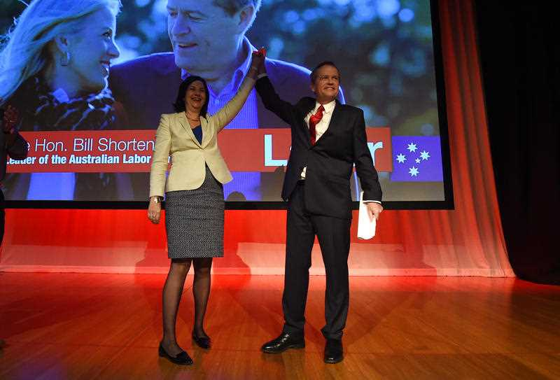 Federal Opposition Leader Bill Shorten and Queensland Premier Annastacia Palaszczuk (left) wave to a cheering crowd at the ALP Queensland conference in Brisbane, Sunday, Aug. 30, 2015.
