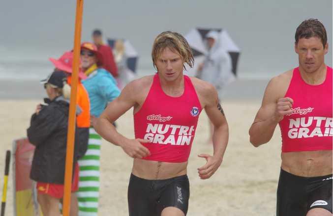 CHAMPION: Lincoln Dews runs up the beach during a surf lifesaving event.
