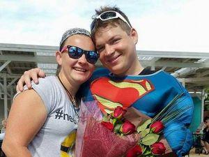 Customers cheer as Superman wins his Lois Lane