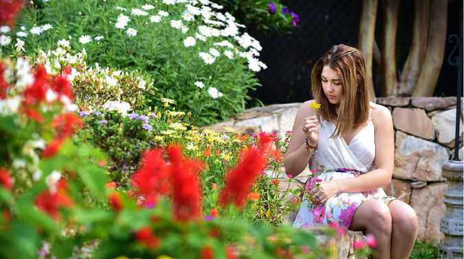 SITTING PRETTY: Deni Barnett, of Coolum, enjoys the warmth of spring in the garden.