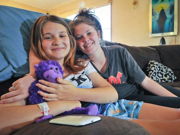Breeanna Feeney recovers at home with her sister Courtney. It is expected to take 18 months for Breeanna to fully recover after being hit by a car.
