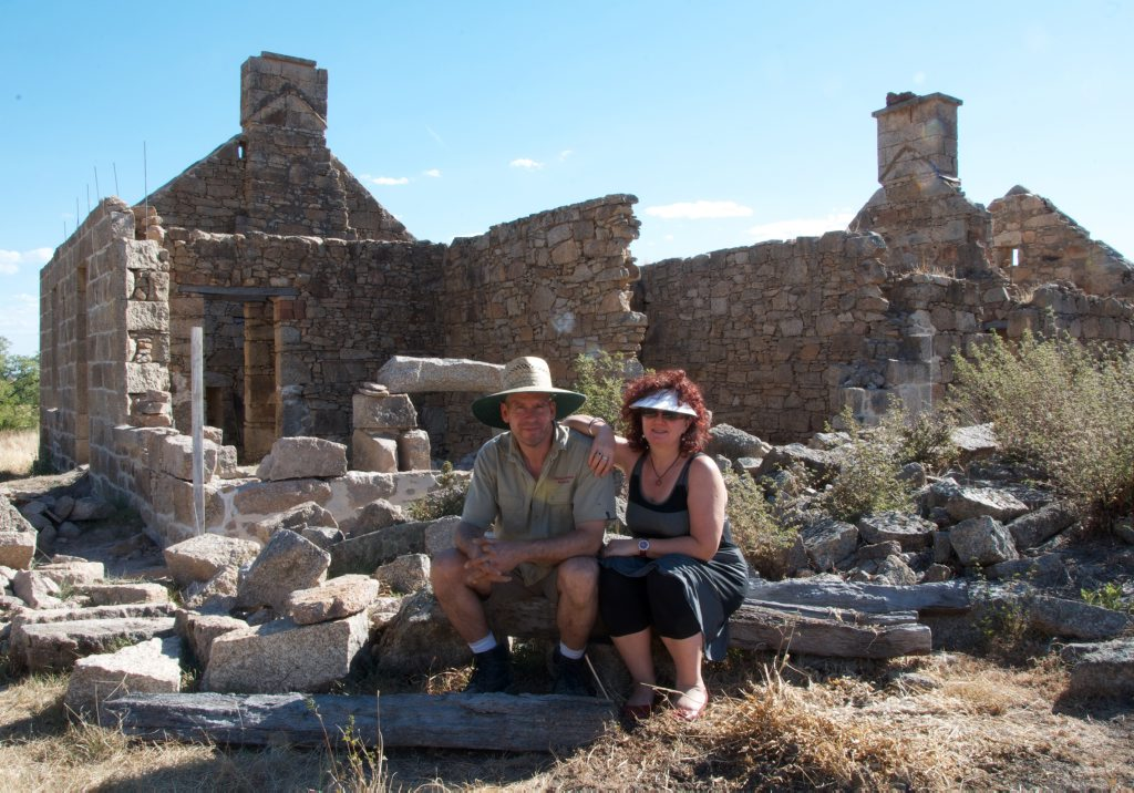 Clay and Narelle pictured in front of the ruins of Keith Hall in a scene from Restoration Australia.