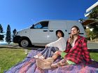 Jy-Leigh Wilson and Toby Vergens were relaxing in their van at Moffat Headland when a group of men began terrorising the area. As many as eight police cars arrived on scene, officers with guns drawn, and arrested several suspects. Photo: Che Chapman / Sunshine Coast Daily