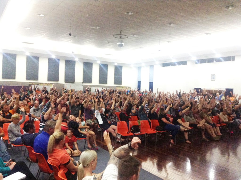 SUPPORT: All hands were in the air at the CFMEU convened meeting in Blackwater, discussing the future of the town, after BHP Billiton Mitsubishi Alliance announced it would contracts to EDI Downer, and 306 local jobs were up in the air. Photo Meghan Kidd / CQ News