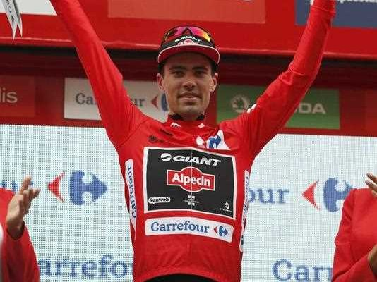 Overall leader Dutch cyclist of Giant team Tom Dumoulin celebrates on the podium after the tenth stage of the La Vuelta 2015 Spanish cycling race, 146,6 km between Valencia and Castellon, eastern Spain, 31 August 2015.