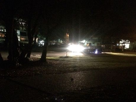 A witness took a photo of last night's Moffat Beach car park scene where an 18-year-old man was allegedly robbed and bashed with a surfboard. PHOTO: Supplied
