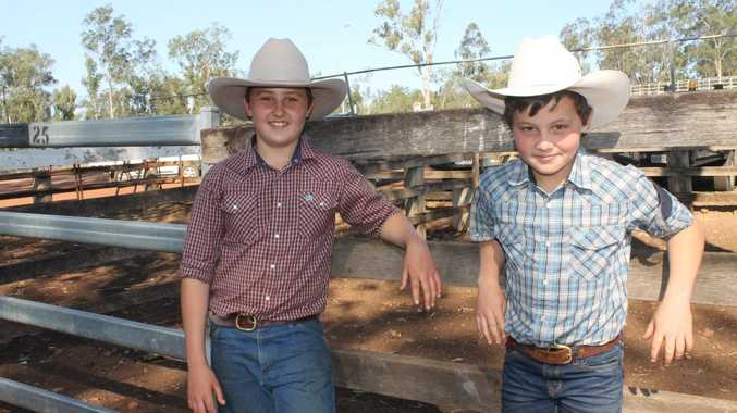 FAMILY FUN: Ben and Zac Reid's parents were stud sellers on the day. The boys came from Kingaroy and got to miss school. Photo Anastassia Perets / Central and North Burnett Times