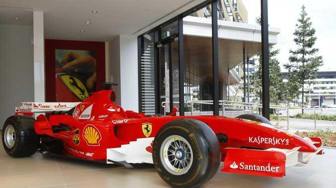 SHOW STOPPER: Schumacher-era 2006 Ferrari F1 car part of current display at newly opened Ferrari Brisbane dealership