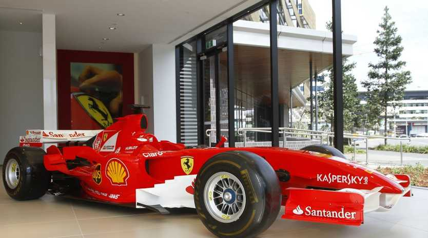 SHOW STOPPER: Schumacher-era 2006 Ferrari F1 car part of current display at newly opened Ferrari Brisbane dealership