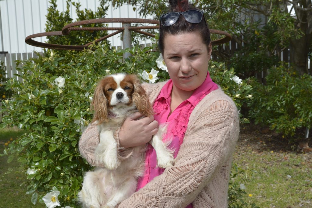 DOG ACT: Mel Daley, with her surviving pet dog Abby, fears her other dog Snoopy was kicked to death.