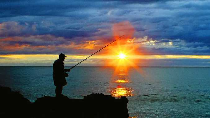 SUNRISE OVER SEA: An angler fishing at dawn at Yamba's Turners Beach. PHOTO: DEBRAH NOVAK