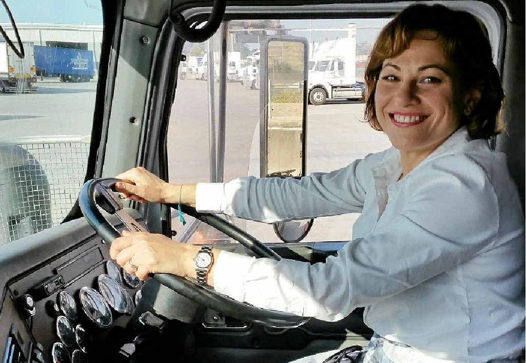 The deputy premier Jackie Trad takes the wheel of Aussie Helpers' new truck.