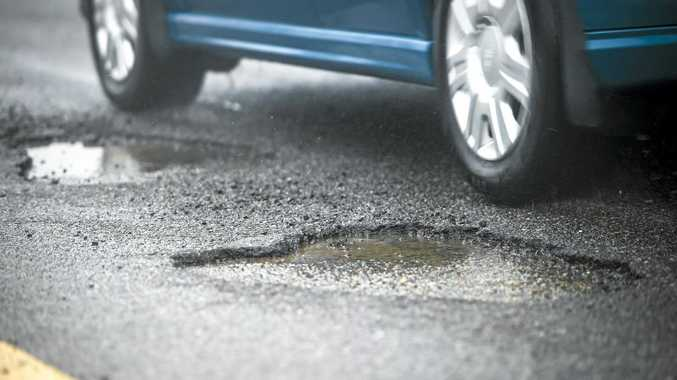 BLACK HOLES: The NSW Government agrees councils don't have enough funding to maintain their local roads.