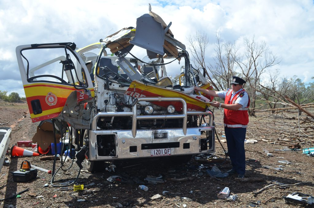 Queensland Fire and Emergency Services Inspector Warren Buckley assesses the damage to the Charleville branches aplha vehicle.