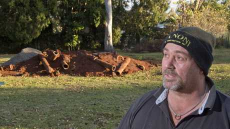 Rangeville resident Geoff Castle is concerned over asbestos pipes being dumped in parkland across from Heller St.