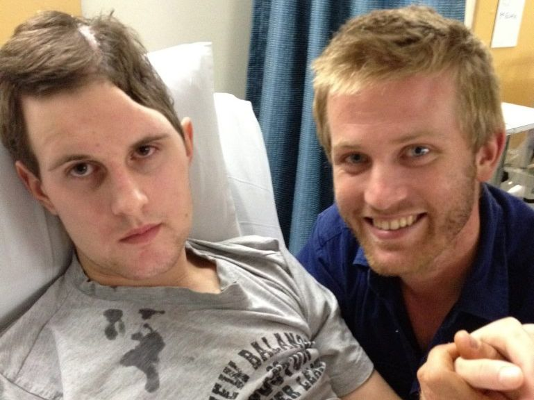 Early 2012 a few months after the accident. Luke after having a hand sized piece of skull removed to save his life. Nathan Reinbott (brother) to the right. Luke Reinbott Photo Contributed