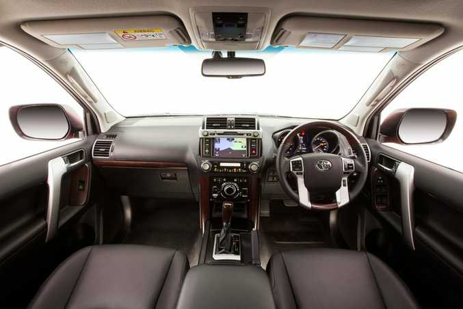 CABIN SPACE: Prado's interior is unchanged; still a good place to be, but instrument panel showing its age compared to SUV rivals