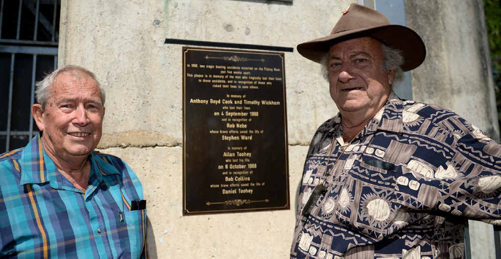 FINALLY RECOGNISED: Rob Nebe and Bob Collins, who both rescued people from the Fitzroy River Barrage in 1968, with the plaque commemorating the rescues and the lives lost.