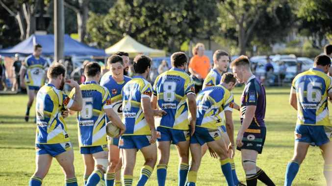 The Mustangs celebrate a try on their way to a big win against Evans Head in the preliminary final.