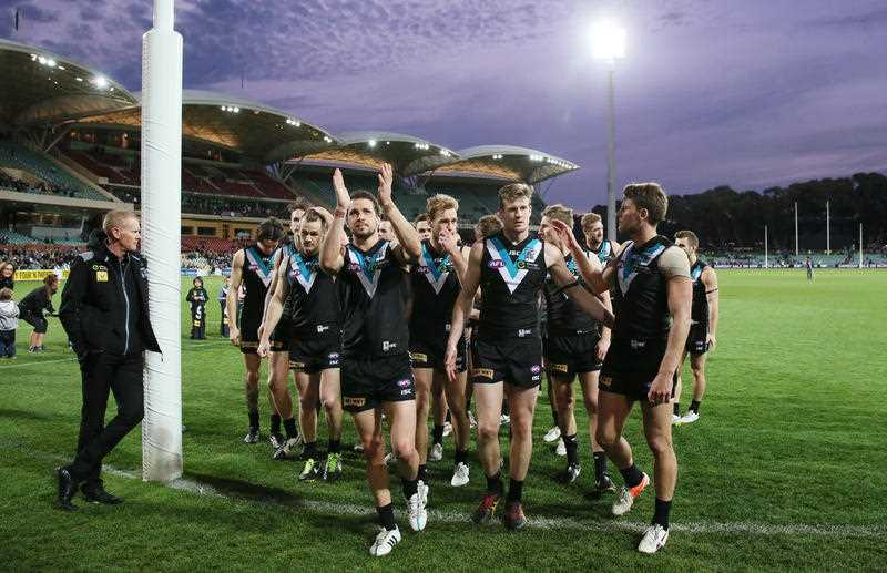 Port Players thanks the supporters as they leave Adelaide Oval for the final time in the 2015 season during the Round 23 AFL match between Port Adelaide Power and the Fremantle Dockers at Adelaide Oval in Adelaide, Saturday, Sept 5, 2015.