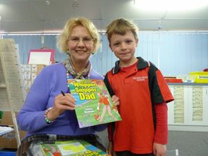 Teacher turned author returns to school