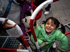 Jara from Syria smiles as she and her family arrive at the main train station in Munich yesterday