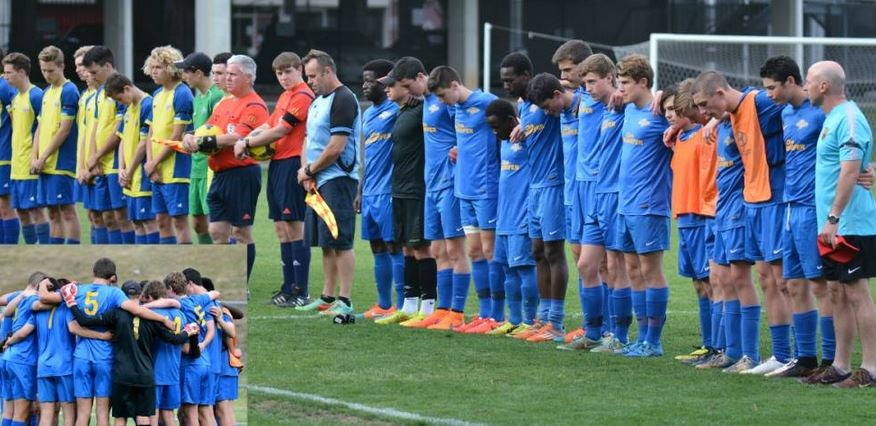 Lachlan Percy's team mates stand in silence during Sunday's football fixture.