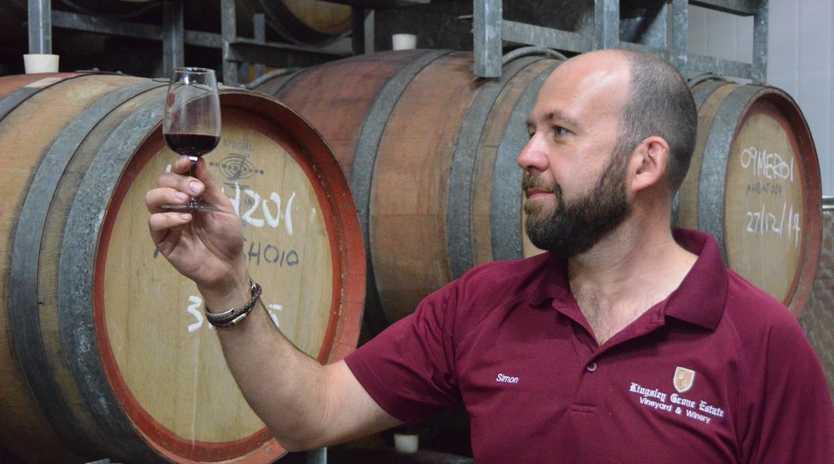 KINGSLEY GROVE ESTATE: General Manager Simon Berry sampling the wine. Photo Rhiannon Tuffield / South Burnett Times