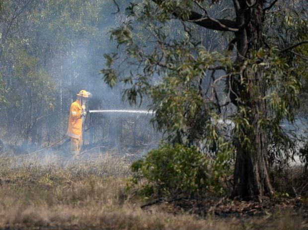 Rural fire brigade voluteers at a grass fire near The Caves. Photo Allan Reinikka / The Morning Bulletin