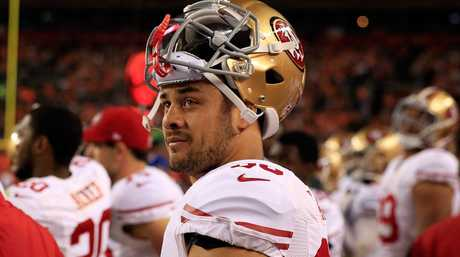 Jarryd Hayne #38 of the San Francisco 49ers looks on from the bench against the Denver Broncos.