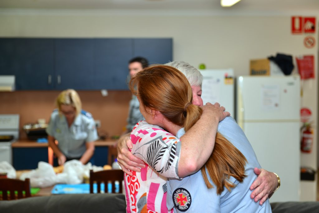 Paramedic Suzette Dakin hugs Maroochydore Ambulance Station officer-in-charge Kathrine Amor during a barbecue lunch today.