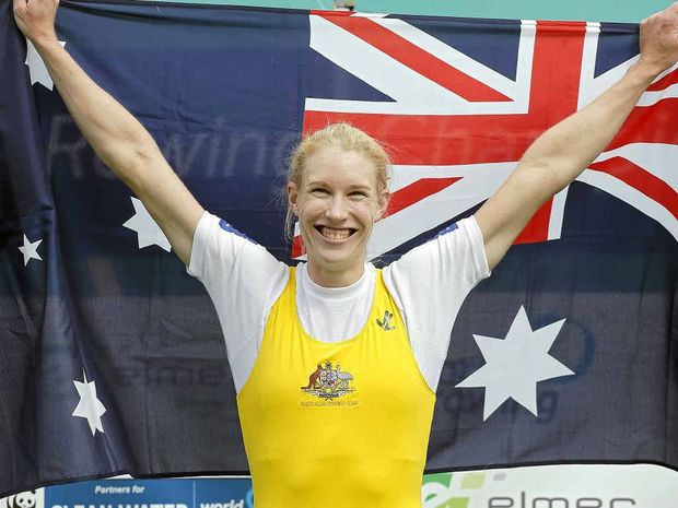 AUSSIE STAR: Kim Crow celebrates on the podium after winning the women's single scull.