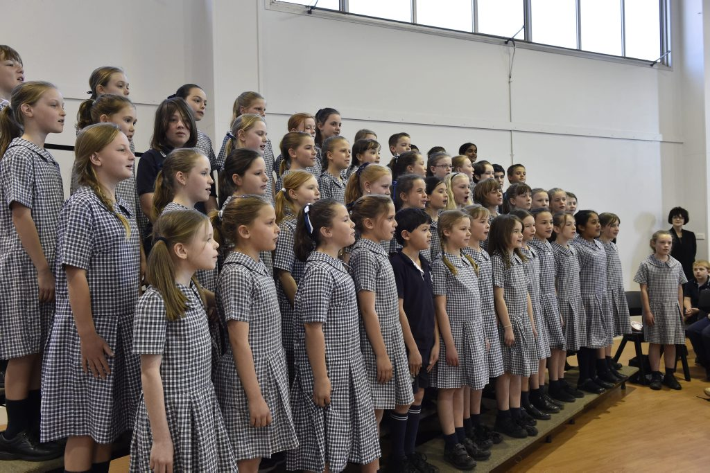 Toowoomba East State School choir sand for the graduating class of 1945 during reunion celebrations at the school.