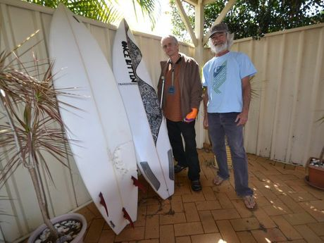 Craig Ison of Evans Head and Darin Reilly of Woodburn with the two boards Mr Reilly has made for Mr Ison. The one on the left has the shark teeth imprint and the other is Mr Ison's new board.