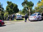 Police take a man into custody at Boyce St, Nambour