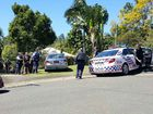 Police take a man into custody at Boyce St, Nambour
