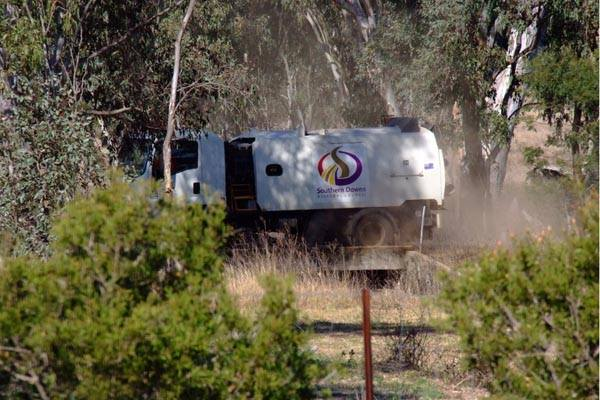 A council street sweeper goes to work in the dusty, country town of Pratten, north-west of Warwick.