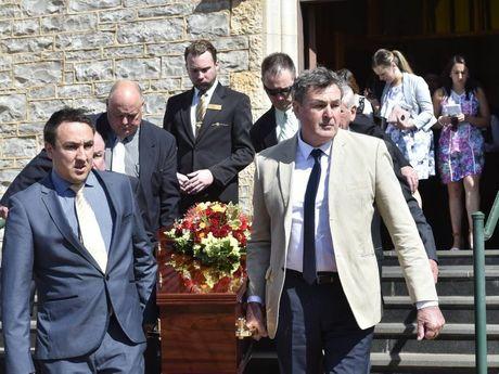 Pall bearers James O'Shea, John O'Shea, Shane Fitzpatrick, David Silver, Graeme Scheu and John McDonald at the funeral for Pat O'Shea at St Patrick's Cathedral.