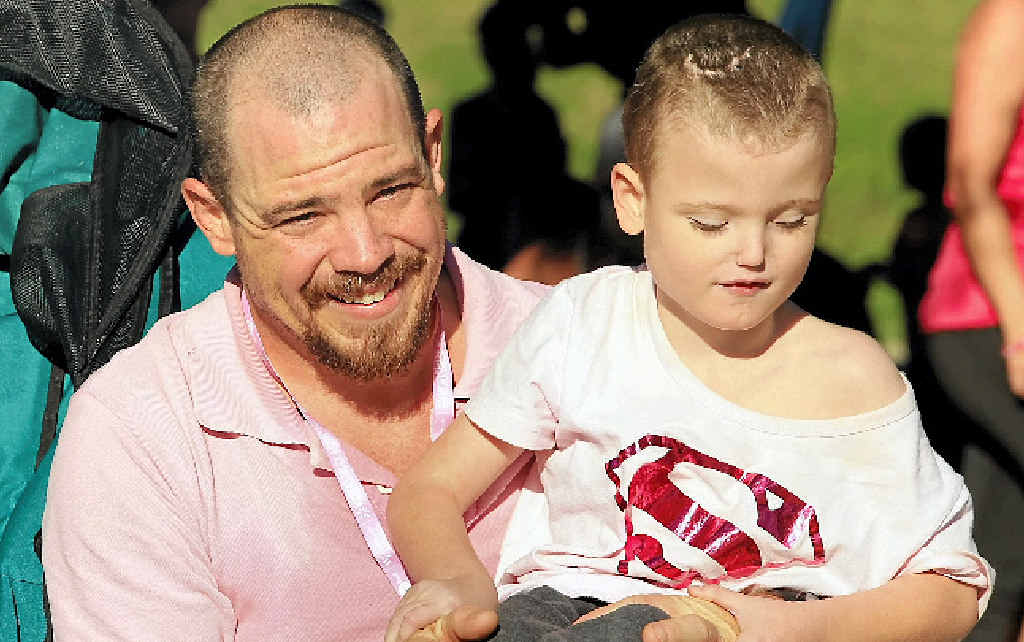 HELP NEEDED: Cameron Harris with his son Aedan who needs around-the-clock care says they and many other families need the NDIS.