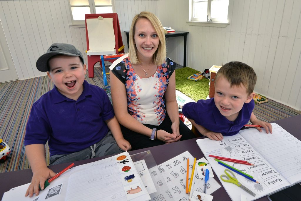 A new school for autistic children has opened up on the Coast in Landsborough. (from left) Brandon Douglas and Emmit Smith are both autistic, with teacher Elizabeth Vaughan.