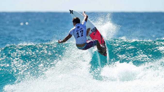 SPONSORSHIP: The struggling surfwear company is expected to maintain its support for events like the Quiksilver Pro Gold Coast, contested by stars like the Coast's Julian Wilson (pictured).