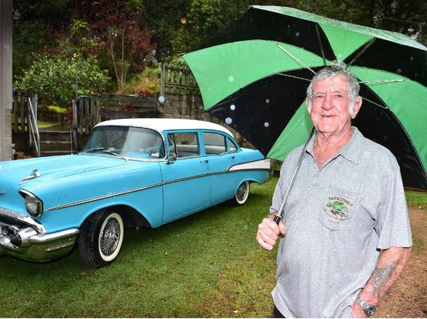 COOL RIDE: Gordon Piper, of Nambour, has a love of old cars and does a fine job of restoring them. He is pictured with his 1957 Chevy with Elvis plates.