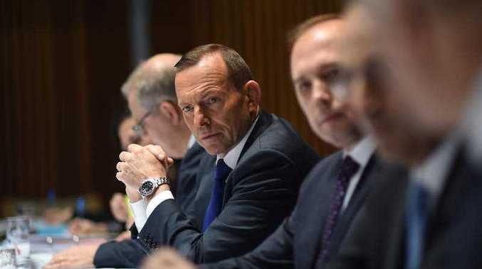 Australian Prime Minister Tony Abbott speaks to social and religious leaders during a roundtable event at Parliament House in Canberra, Friday, Sept. 11, 2015. Abbott is discussing the resettling 12,000 refugees from the conflict in Syria and Iraq.