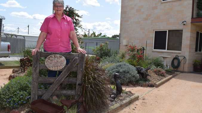 WELCOME TO MY GARDEN: Sue Telford with husband John have created a native garden at the back of their business Biggenden Newsagency and their residence. Photo Erica Murree / Central & North Burnett Times