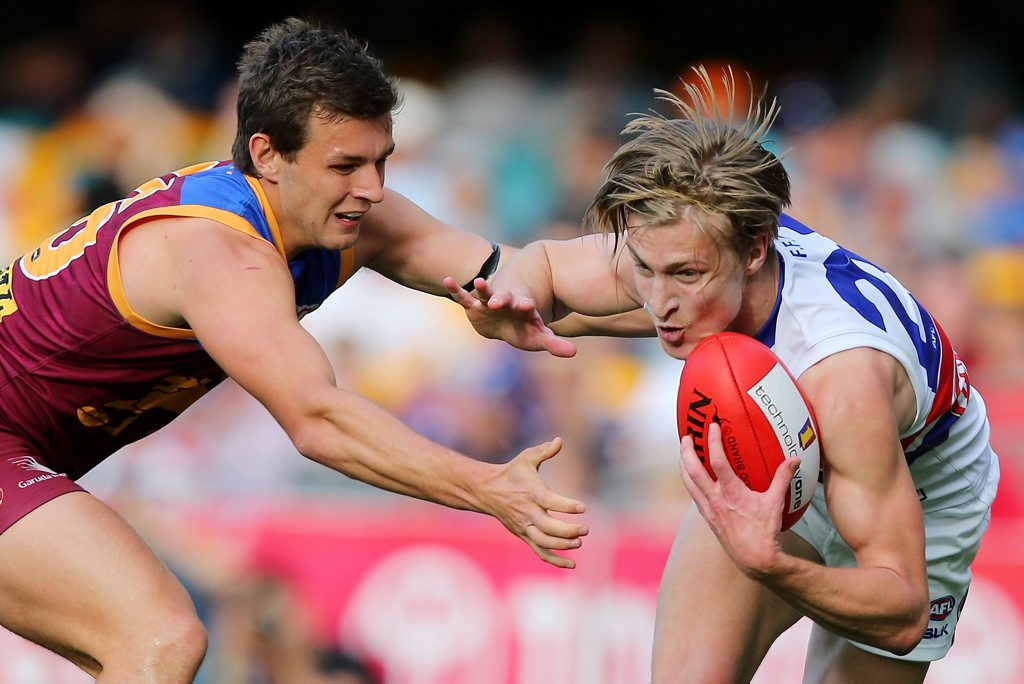 BRISBANE, AUSTRALIA - SEPTEMBER 05: Billy Evans of the Lions tackled Shane Biggs of the Bulldogs during the round 23 AFL match between the Brisbane Lions and the Western Bulldogs at The Gabba on September 5, 2015 in Brisbane, Australia. (Photo by Chris Hyde/Getty Images)