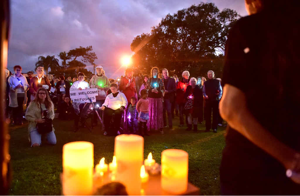 SHOWING SUPPORT: A candlelight vigil was held for refugees in the Cotton Tree park.