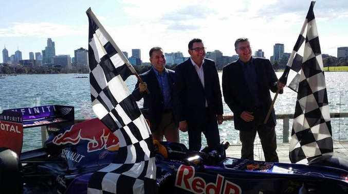 Victorian Premier Daniel Andrews (centre) announces the successful retention of the Formula One Grand Prix for Melbourne, Sunday, Sept. 13, 2015 . Premier Andrews says securing the Formula One Grand Prix for Melbourne until 2023 was a very competitive process.