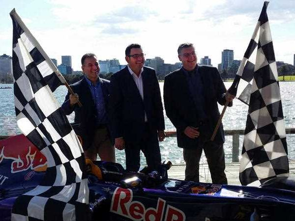 Victorian Premier Daniel Andrews (centre) announces the successful retention of the Formula One Grand Prix for Melbourne, Sunday, Sept. 13, 2015 . Premier Andrews says securing the Formula One Grand Prix for Melbourne until 2023 was a very competitive process.