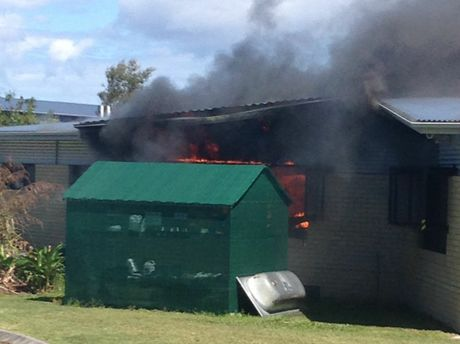 Buildings at Unity College in Caloundra West have been destroyed by fire.