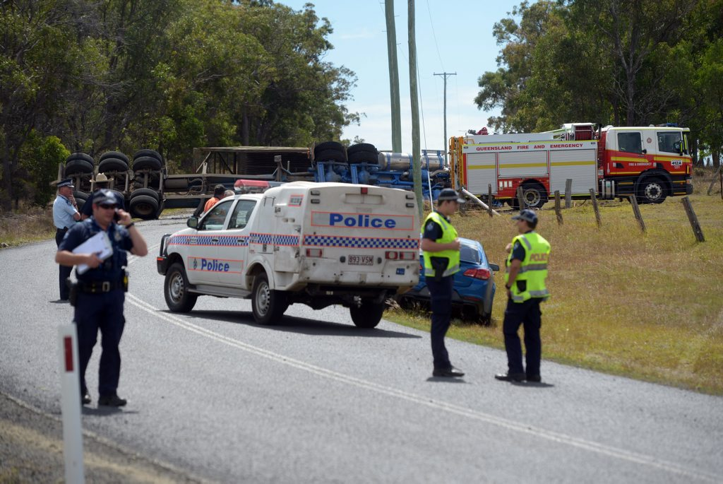 FATAL CRASH: Emergency services attend the scene of a fatal crash involving a cane truck on Moorlands Road on Monday, 14 September 2015. Photo: Max Fleet / NewsMail